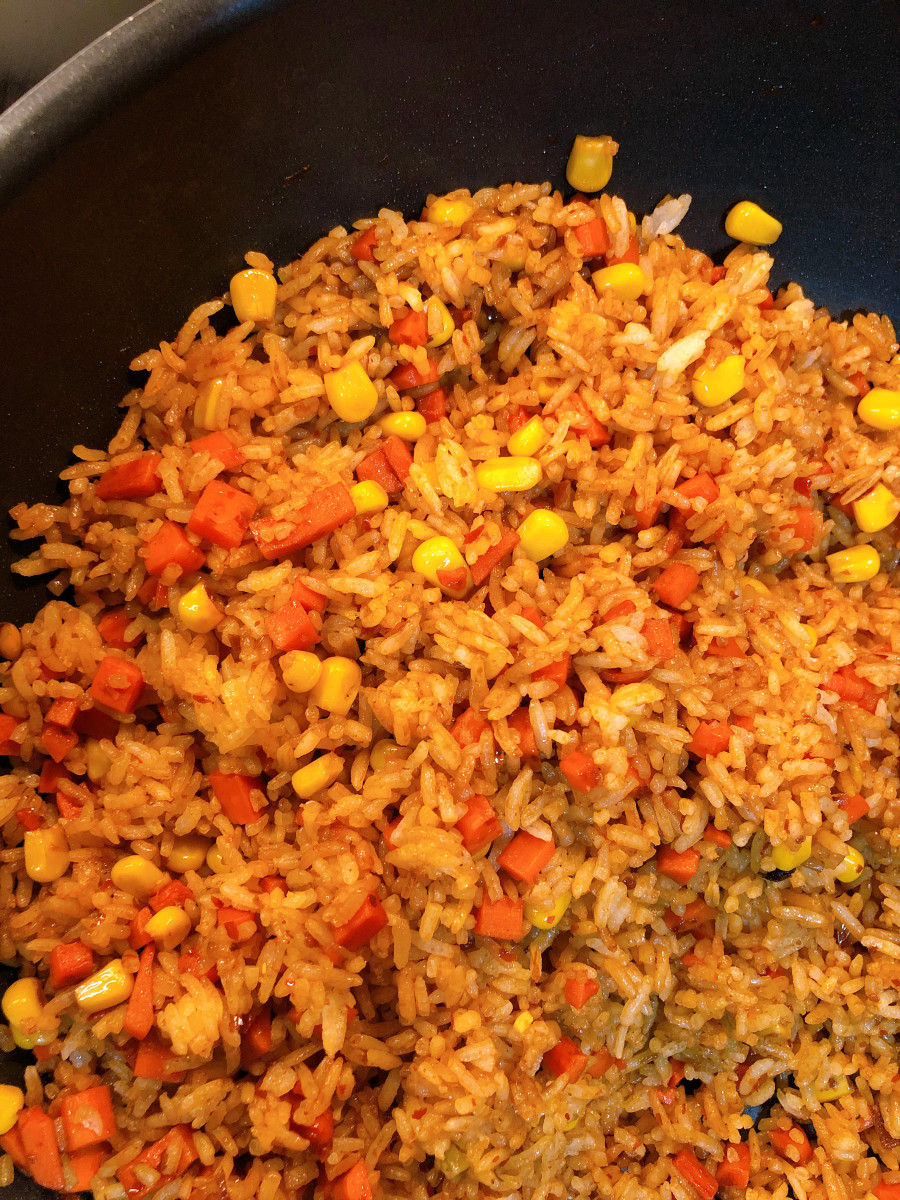 Fried rice is a classic Malaysian dish. It can be cooked with many type of ingredients. This is my vegetable fried rice with carrots and corns.