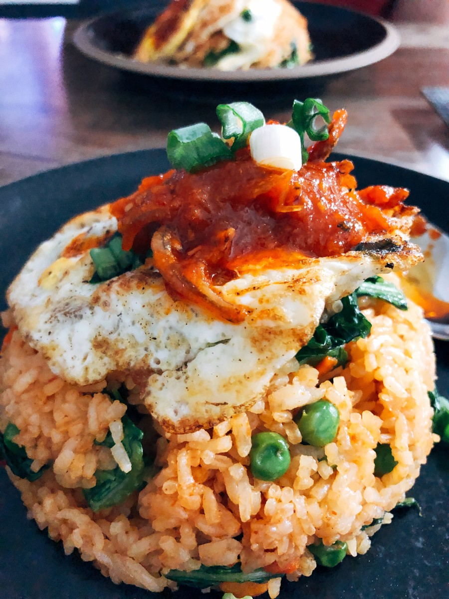 Peas fried rice with a fried egg and spicy sambal.
