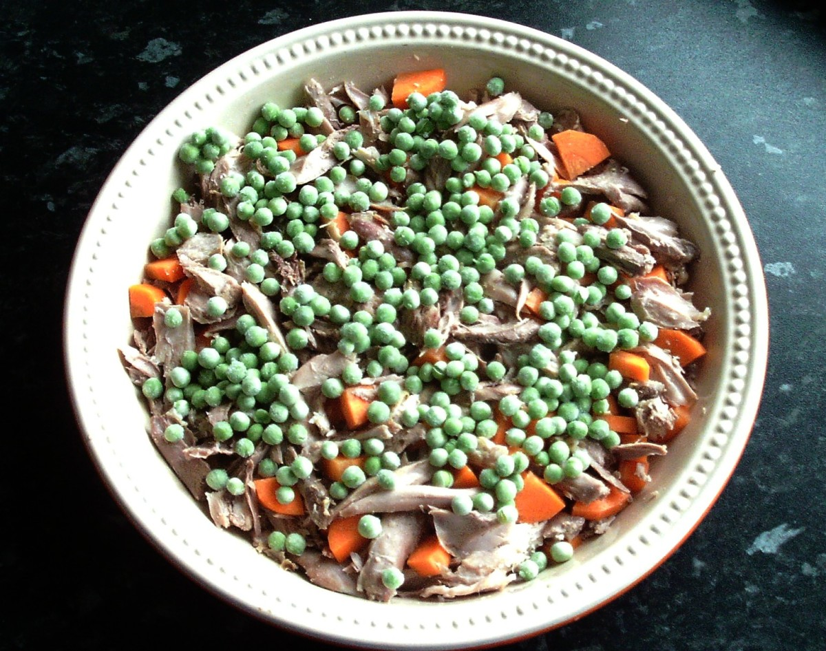Carrot and peas are added to pie meat