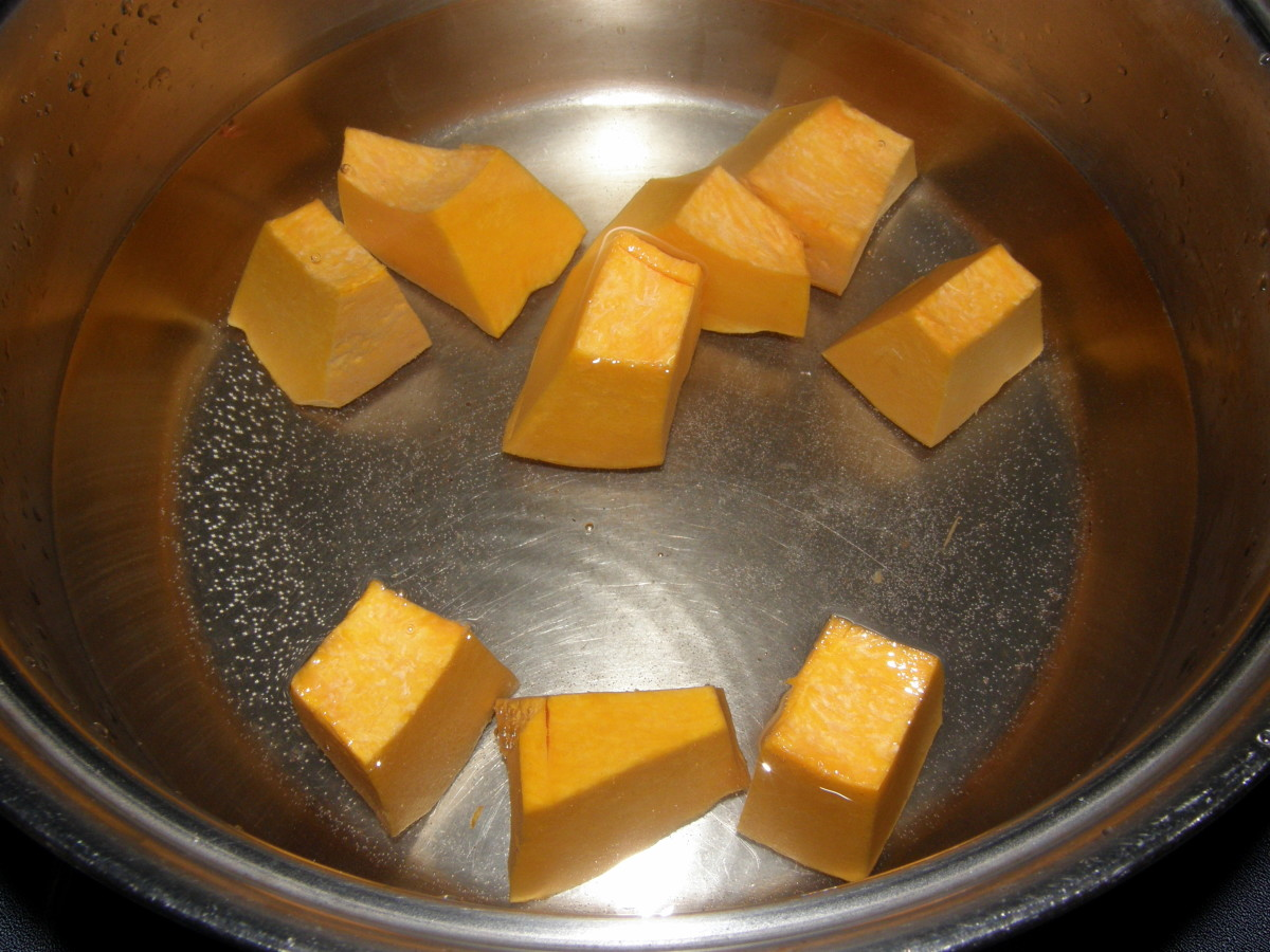 When the water has reached the boil, add the pumpkin cubes. The pumpkin will help to give the soup some color.