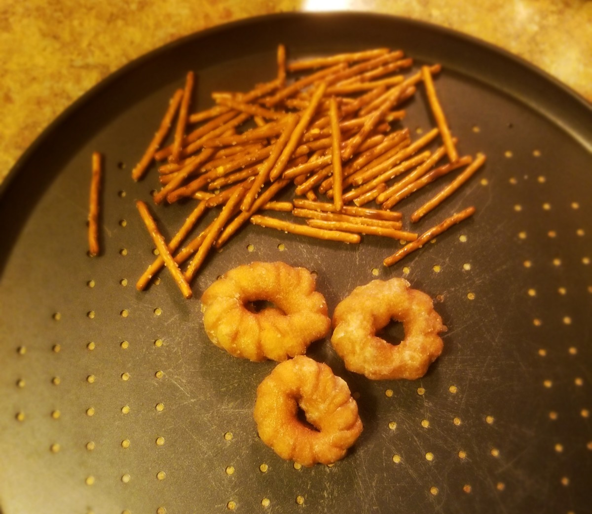Lay out donuts and pretzels.