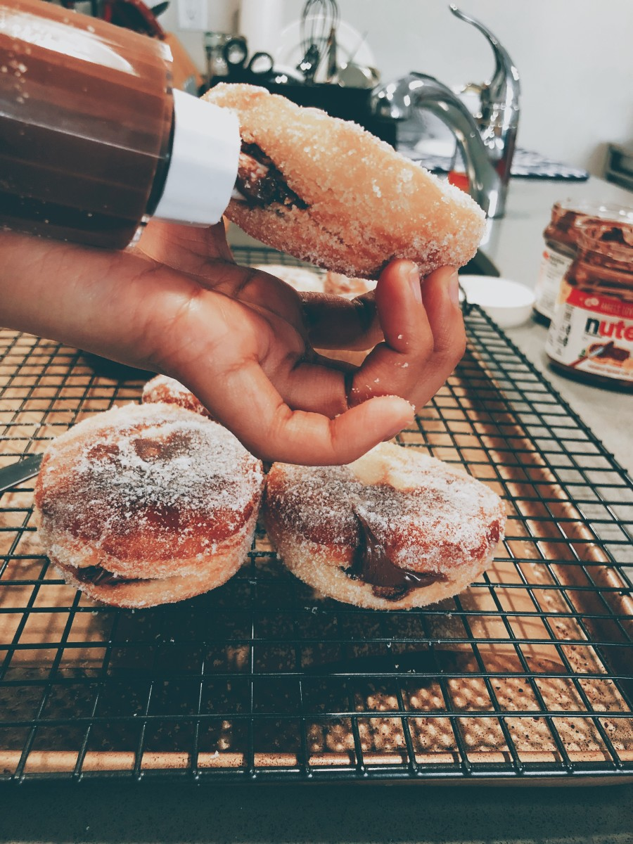 Inject the Nutella into each donut.