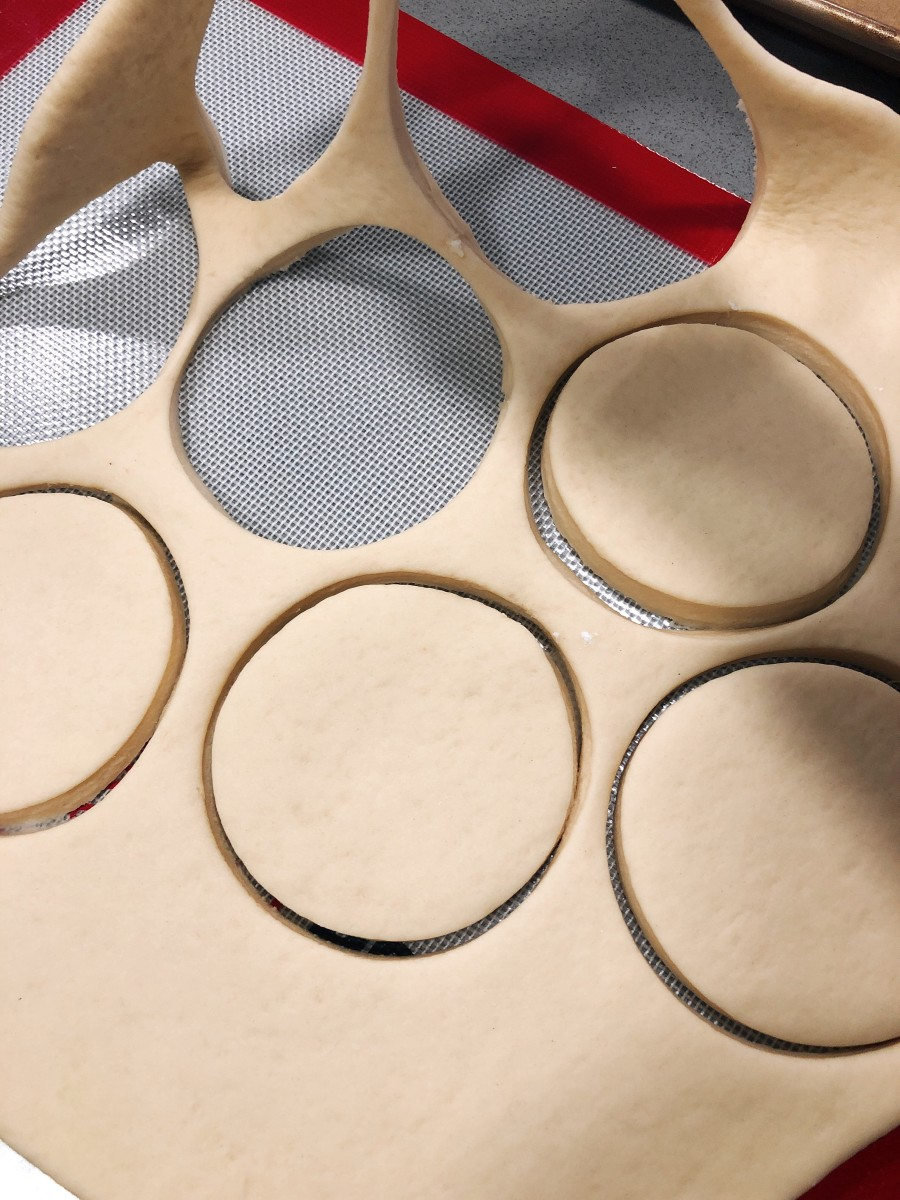 Roll the dough onto a baking mat. Shape the donuts with a donut cutter.