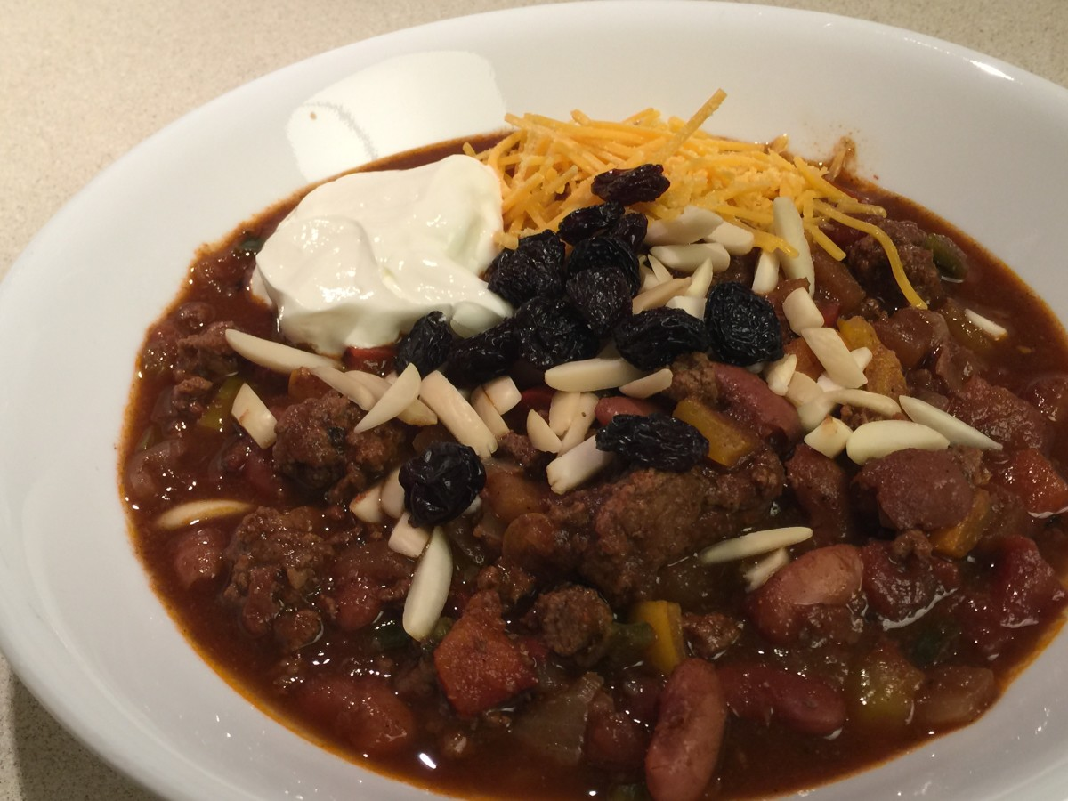 Fruit and Nut Chili with raisins, almonds, cheese, and sour cream