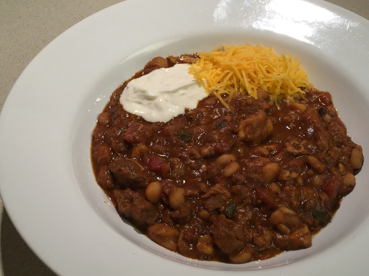 Kitchen Sink Chili with sour cream and cheese