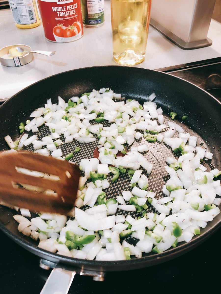 On the other pan, saute the chopped onions with chopped green bell peppers.