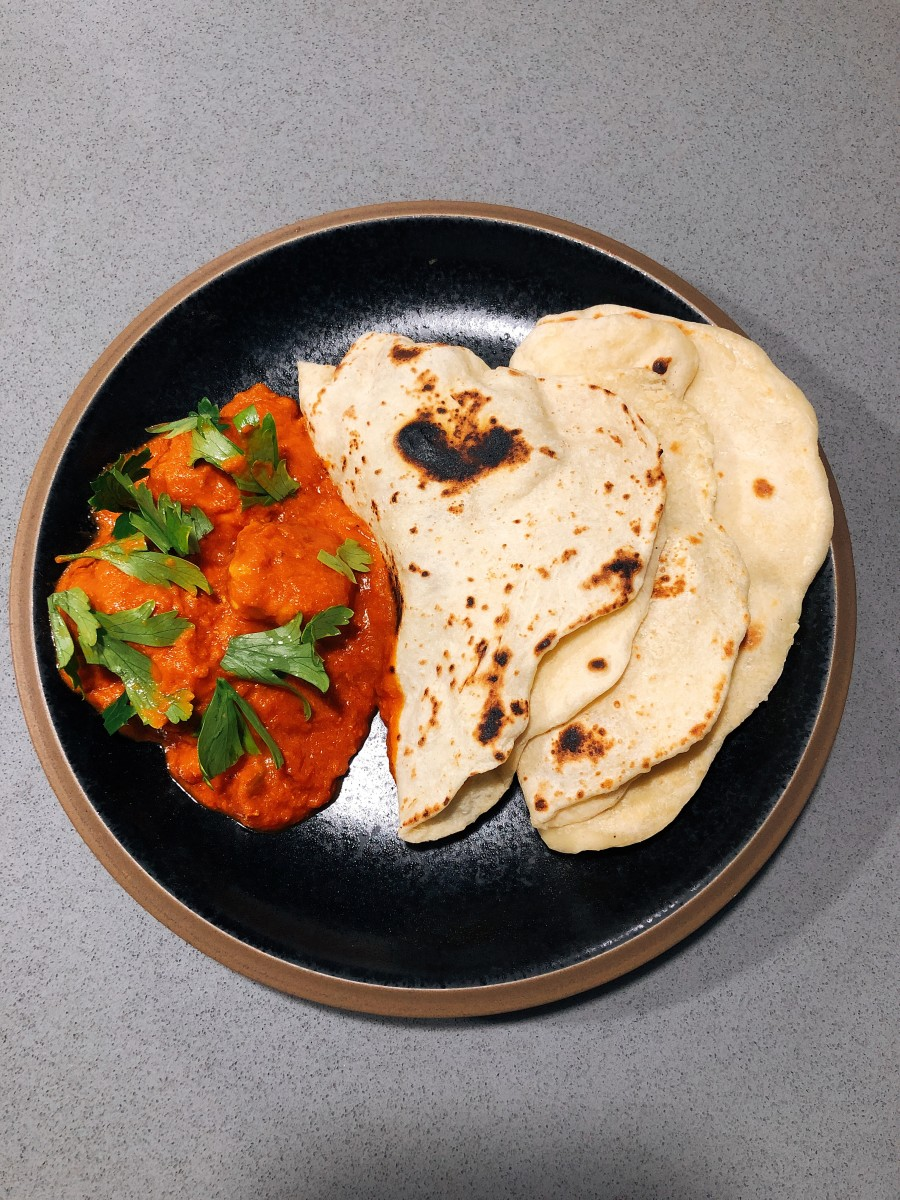 Chicken tikka masala with naan bread.