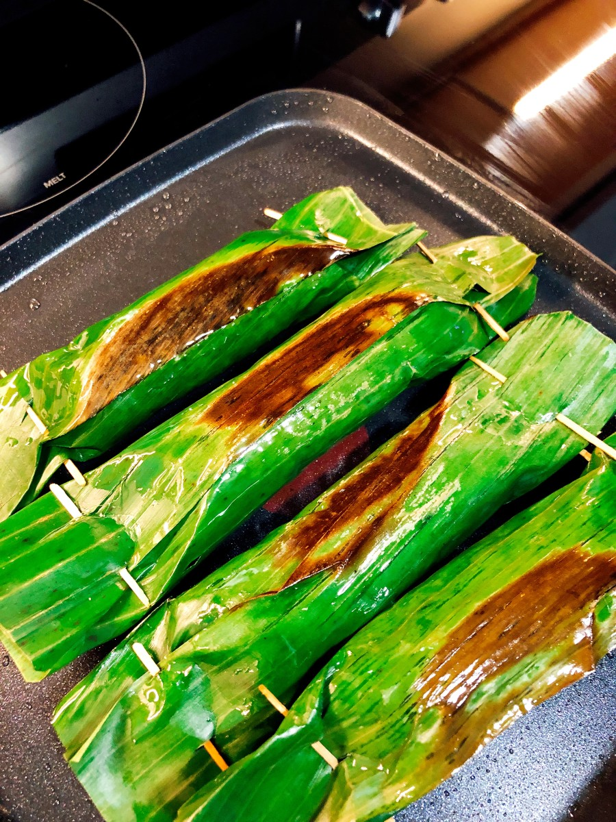 Cook each side for five minutes or more. I like the banana leaves to get a bit scorched.