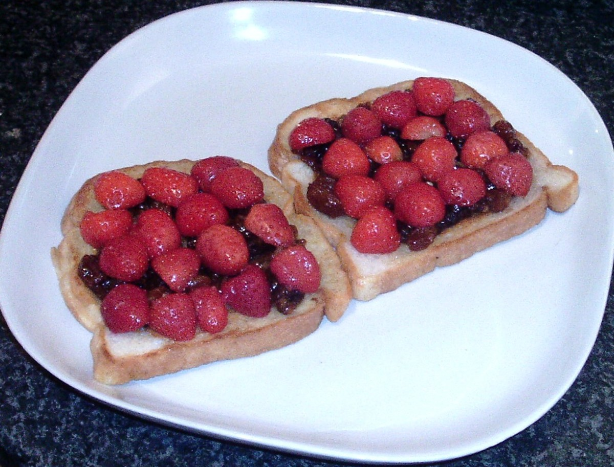 Halved strawberries are arranged on top of spread mincemeat