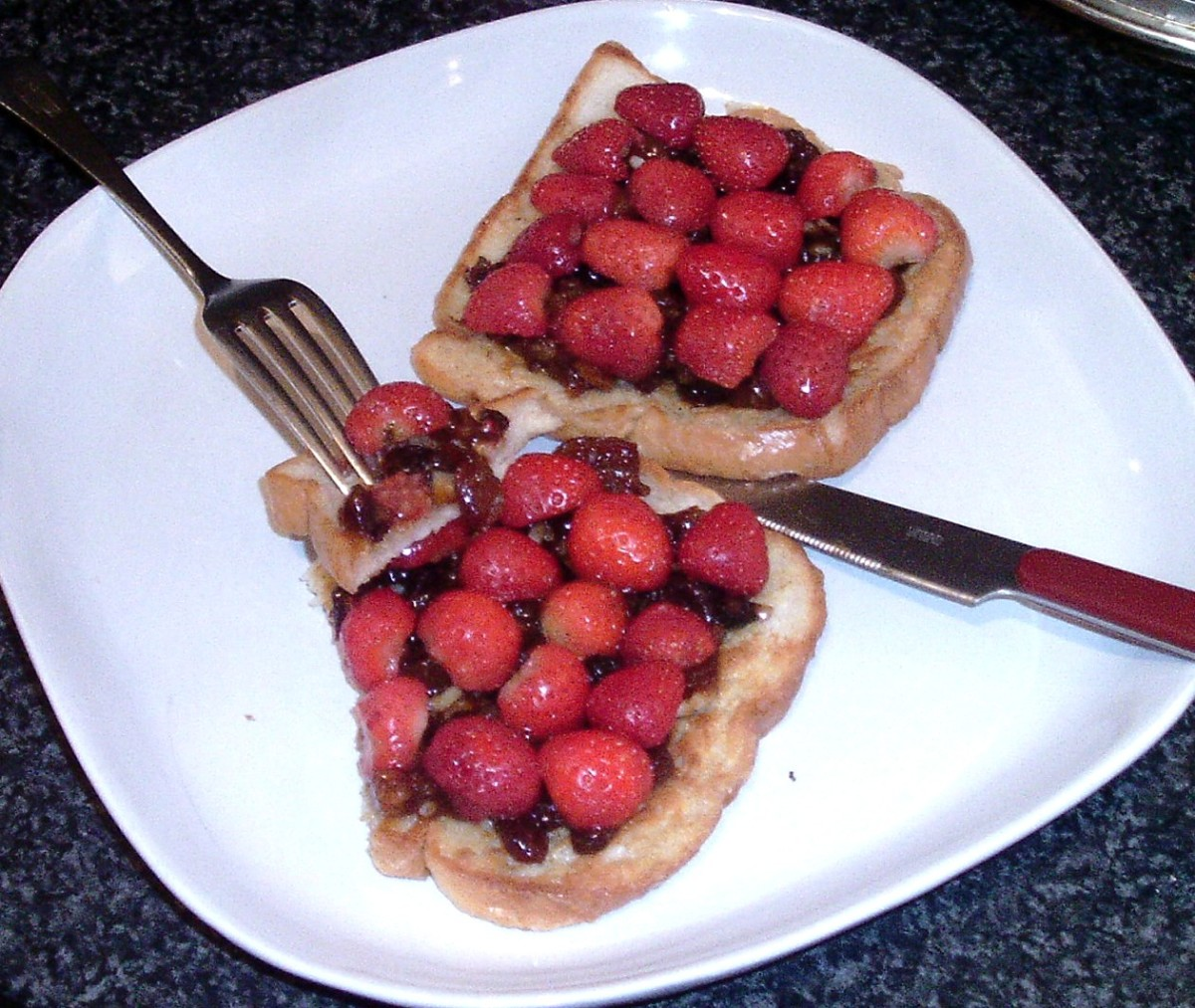 Mincemeat Spread on Cinnamon- and Cumin-Spiced French Toast With Halved Fresh Strawberries Arranged on Top