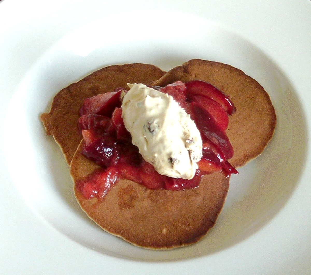 Mincemeat Ice Cream Served With Stewed Plums on Mincemeat Pancakes