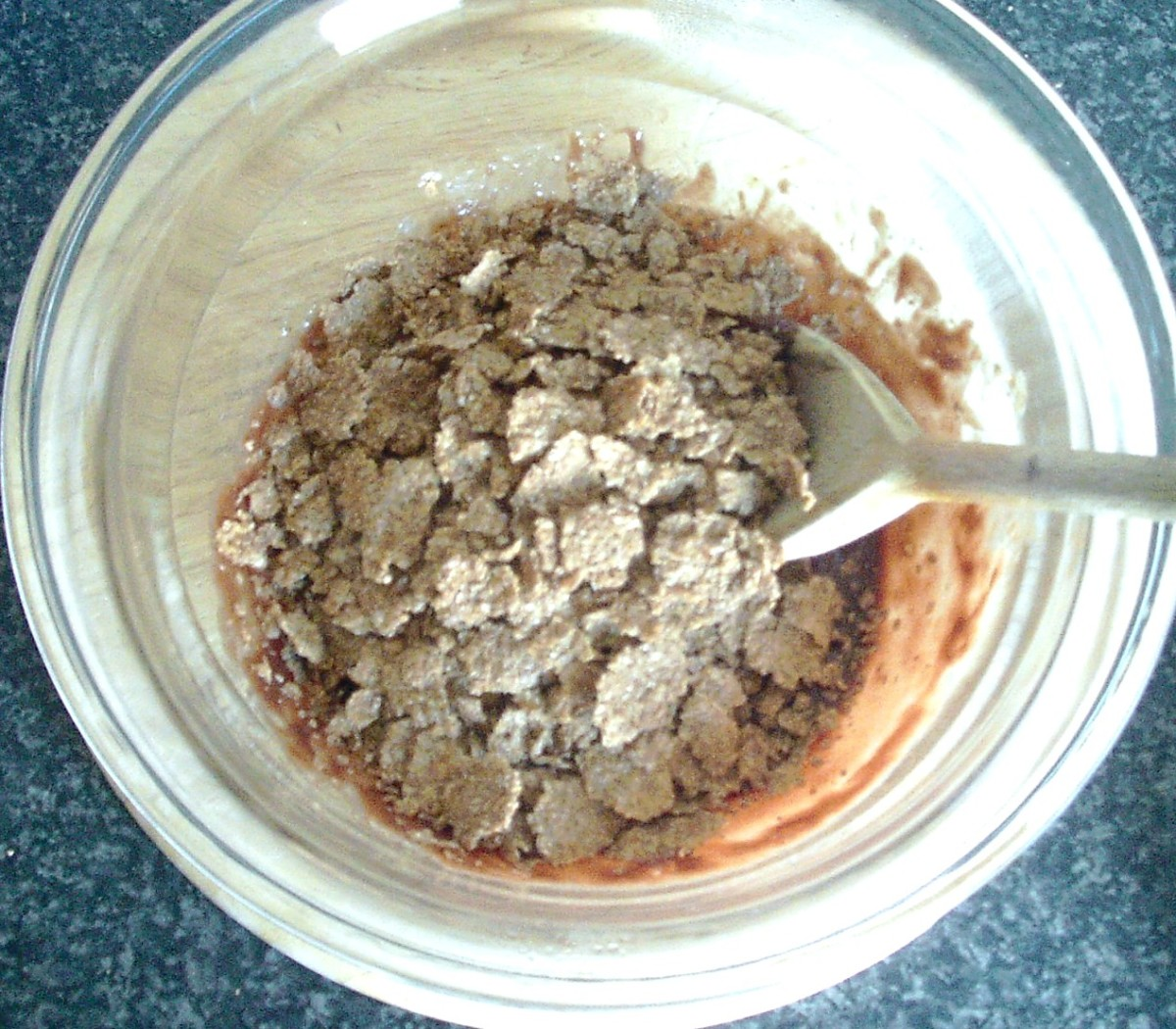 Bran flakes are added to the bowl in stages