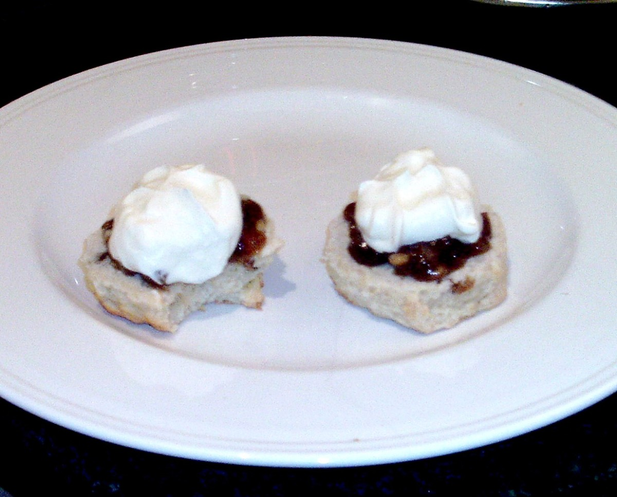 Sultana scone halves are spread with mincemeat and topped with whipped cream