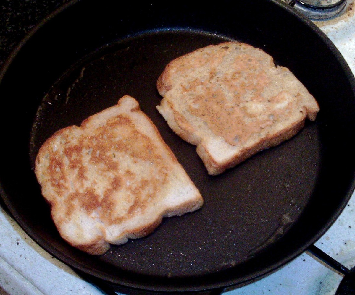 Eggy bread is turned in frying pan