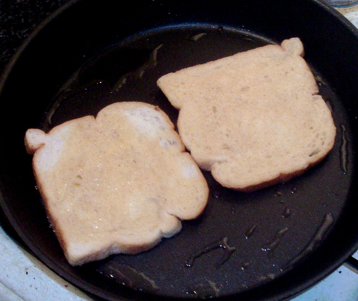 Egg soaked bread is put on to fry