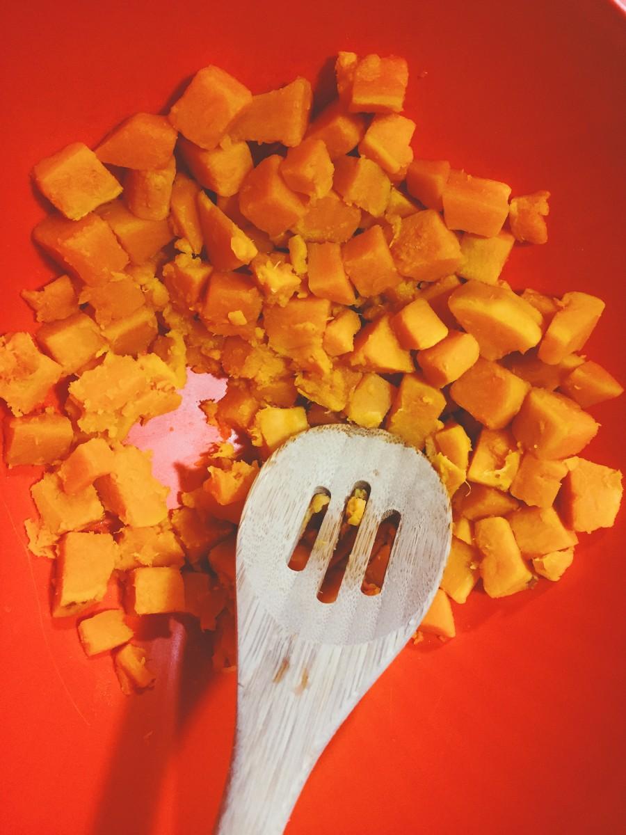 Mash the potatoes using a spatula.