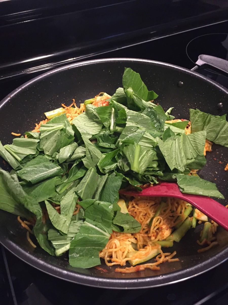Add the mustard greens.