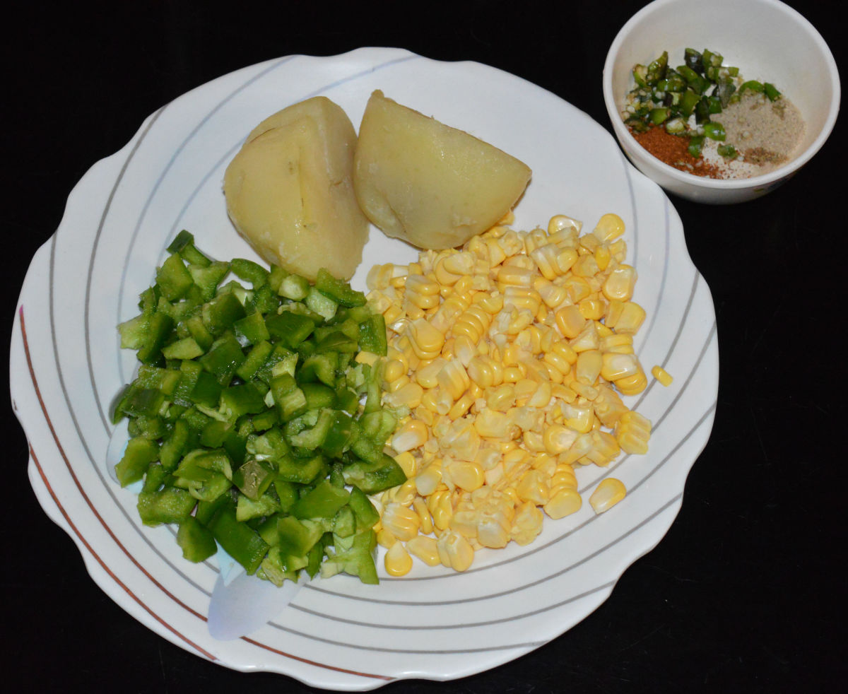 The ingredients for making corn capsicum cutlets.