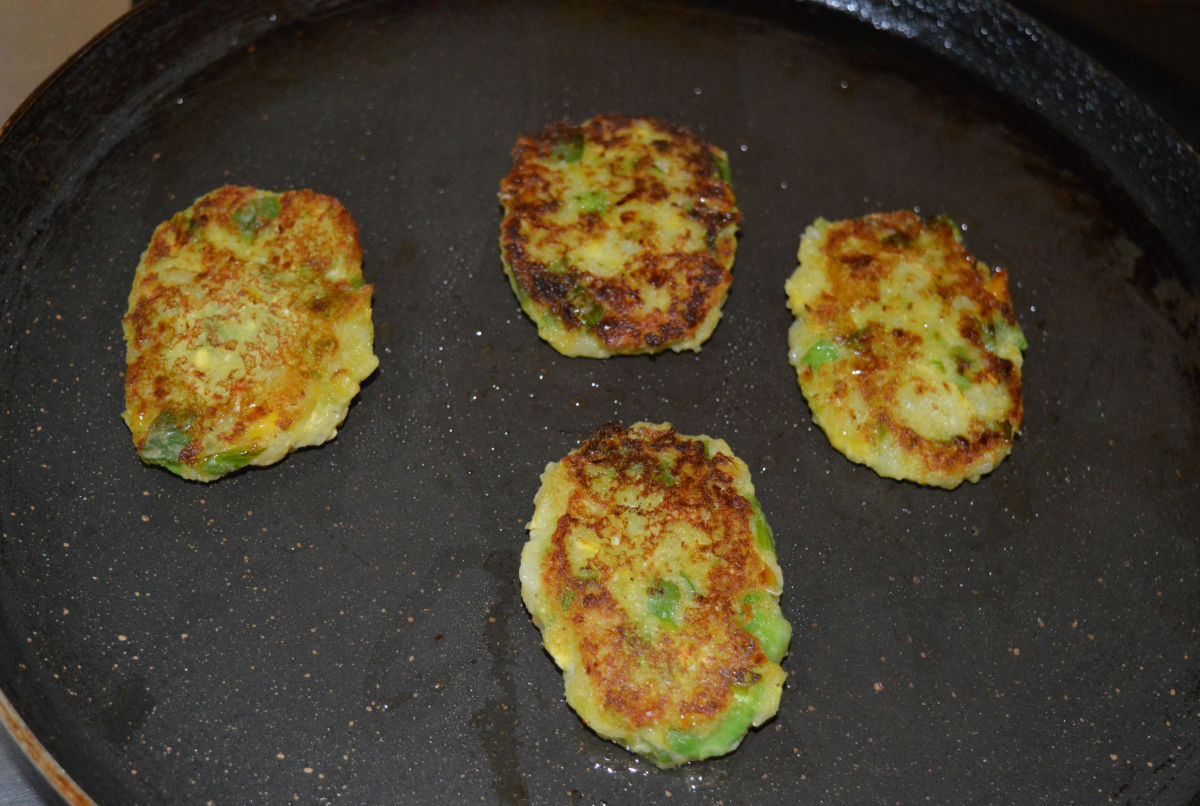 Step four: Flip them when the bottom becomes crispy and golden brown. Add a few drops of oil on the top. Remove the patties from the pan when both sides are golden brown and crunchy.