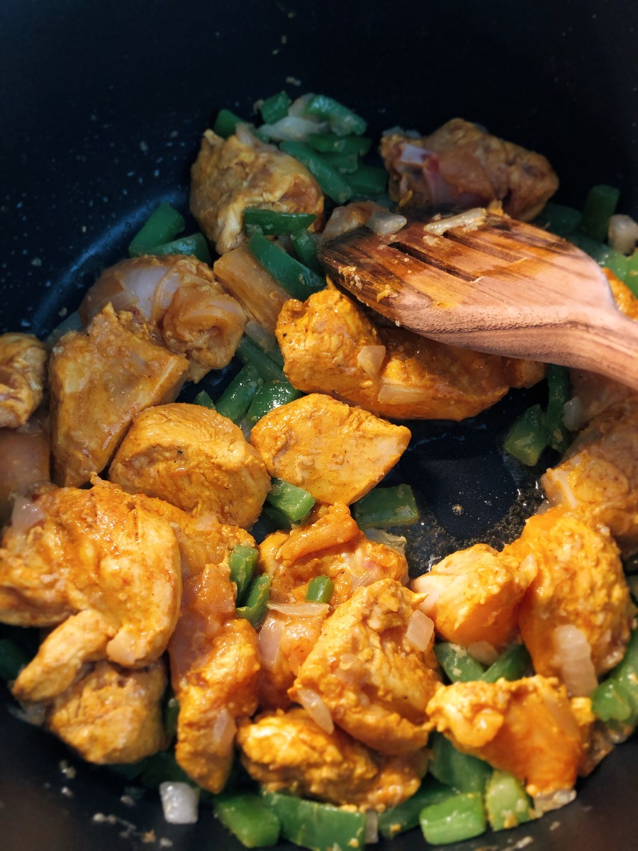 Add the chicken into the pan.