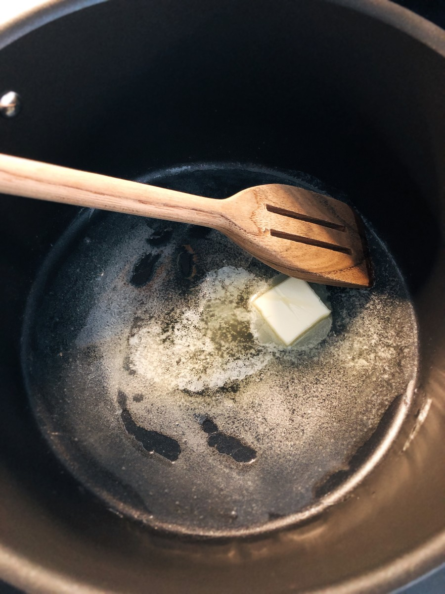 Heat cooking oil with butter.