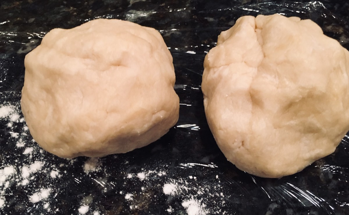 After blending the dough by hand, split it into 2 or 3 balls. I prefer 2.