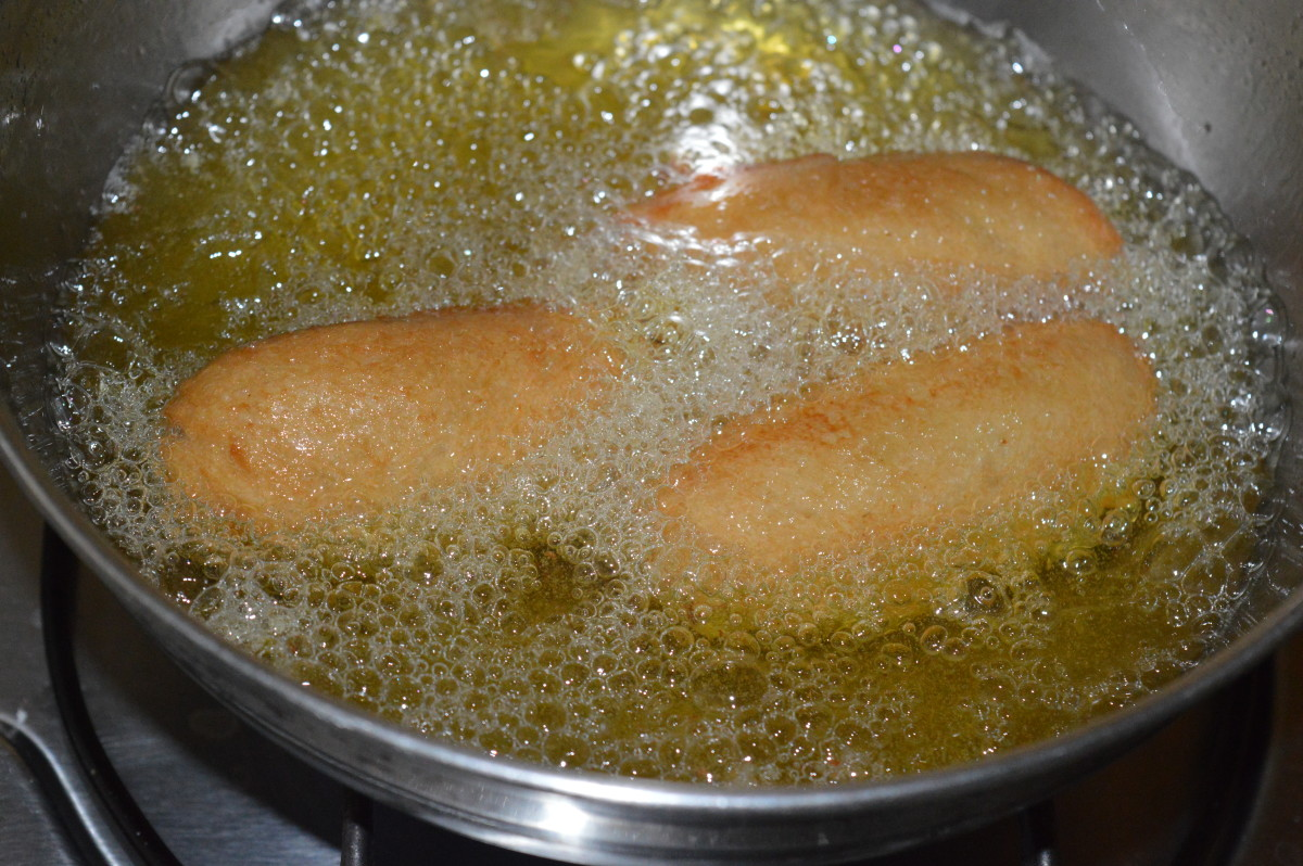 Step five: Deep-fry 3-4 of them in oil until they become light brown. Remove, and place them on an absorbent paper towel.