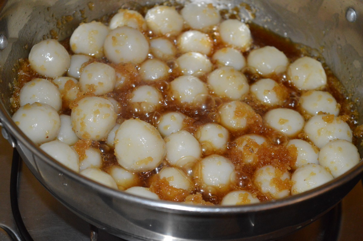 Step seven: Add steam-cooked rice balls. Gently mix them with the jaggery-coconut mixture. Softly stir the mix until you get a semi-solid consistency. Turn off the heat.