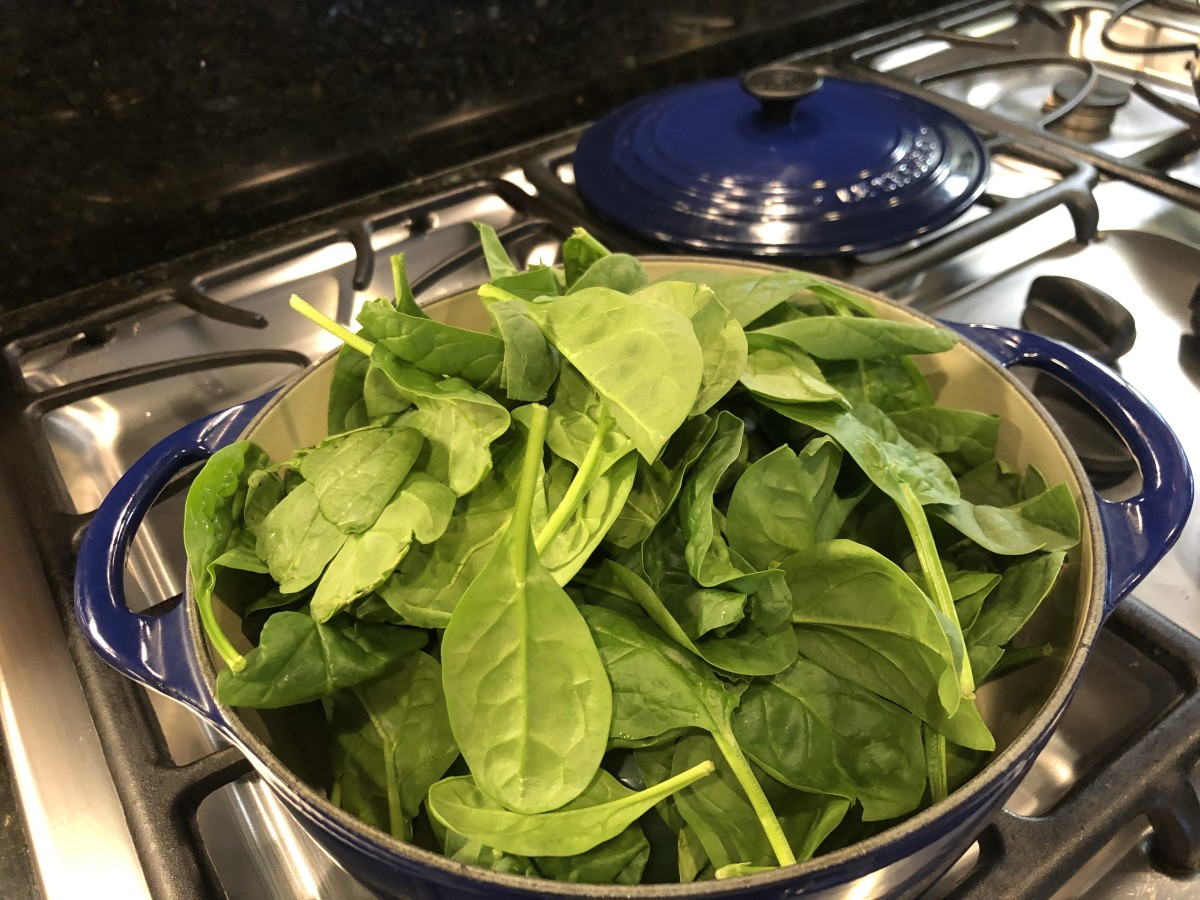 It may seem like the spinach won't fit in the pot, but it cooks down significantly as the spinach leaves wilt