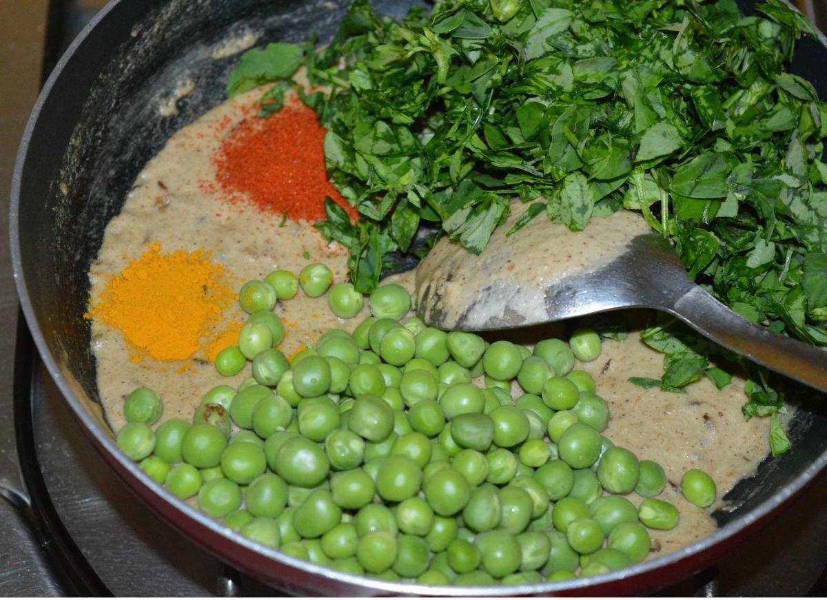 Step five: Add the green peas, chopped fenugreek leaves, turmeric powder, red chili powder, salt, and sugar. Mix thoroughly.