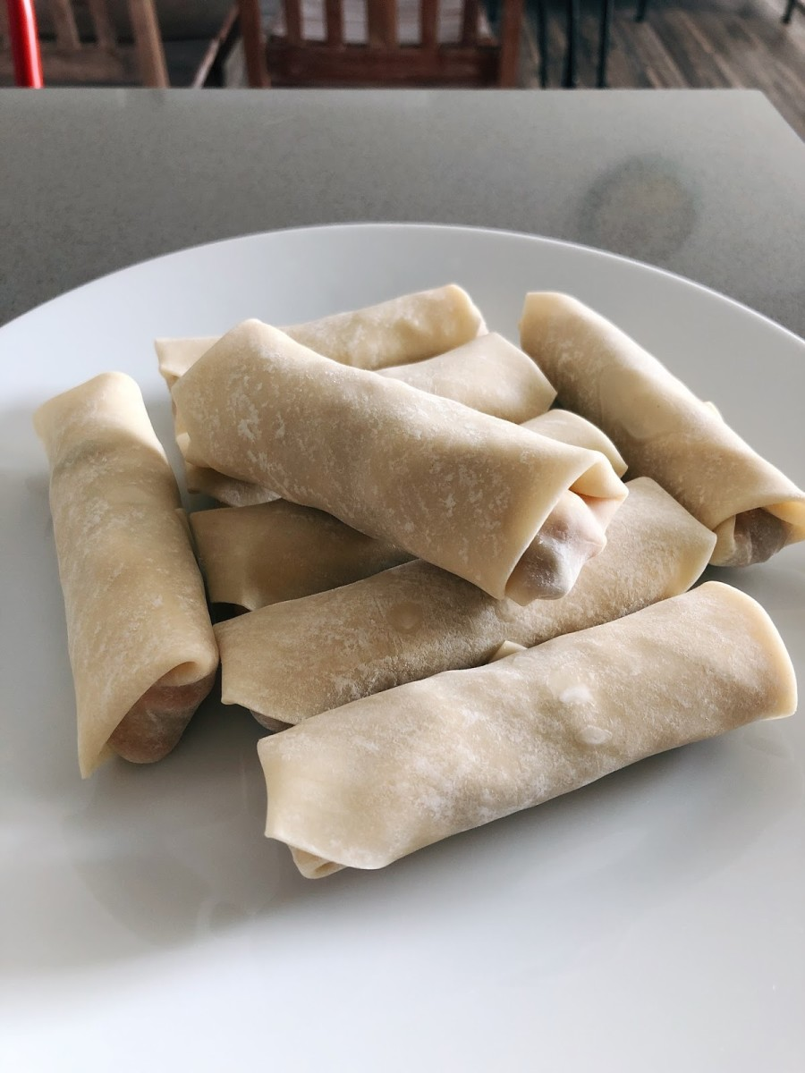 Roll up the wrapper tightly to form the spring rolls.