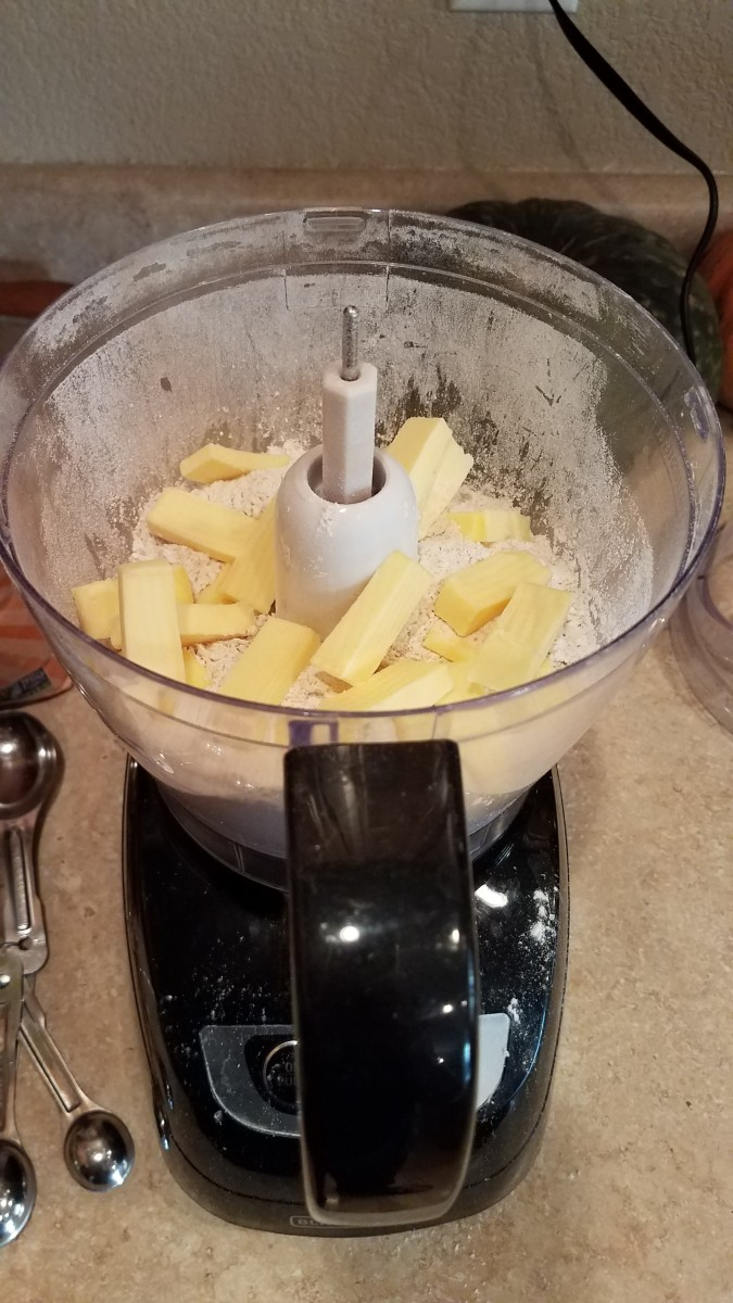 Cut up your cold butter into small chunks and process with your flour.