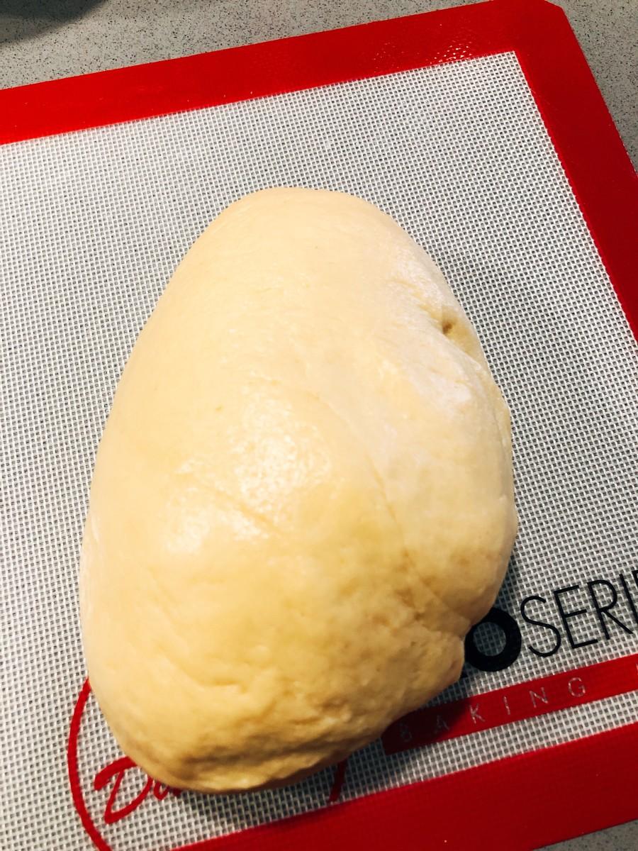 Transfer the dough onto a baking mat.