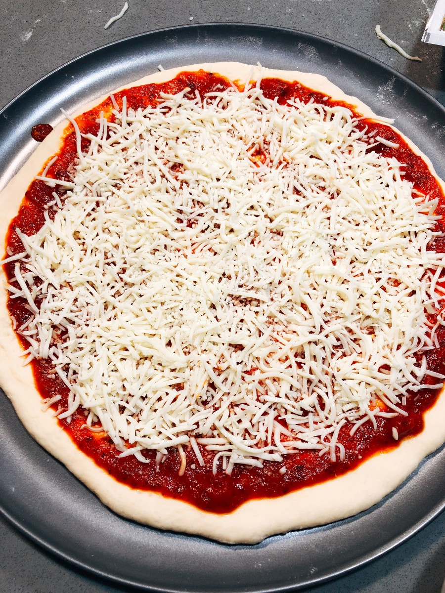 Top the sauce with the shredded cheese.