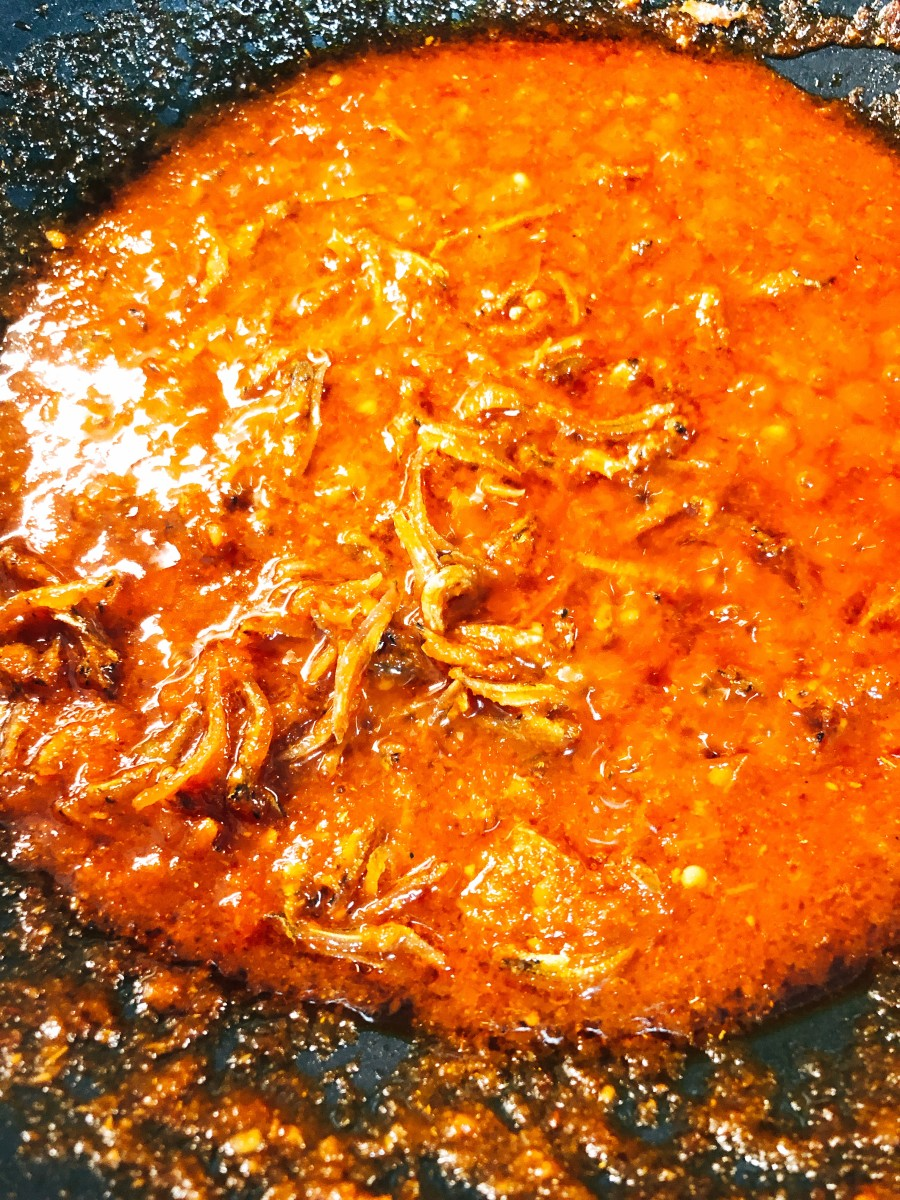 Let the anchovies cook in the sambal for a few minutes before turning off the heat.