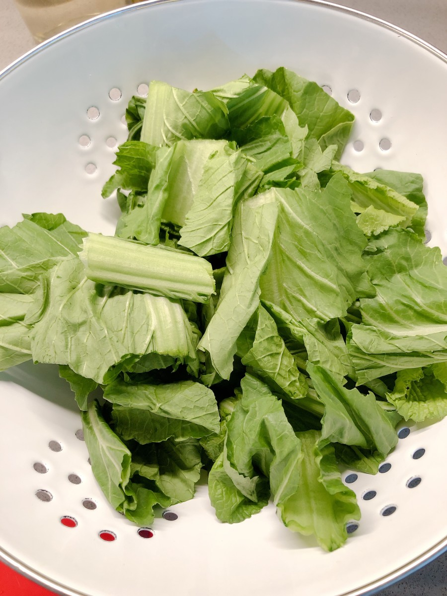 Rinse and chop the mustard greens.
