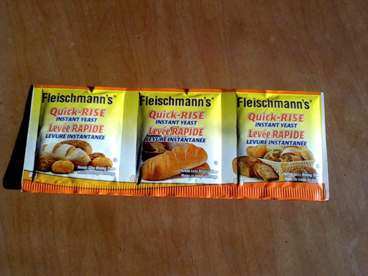 Shown here are 3 small packages of yeast, each containing 8 grams (2 teaspoons). One package is needed per loaf.