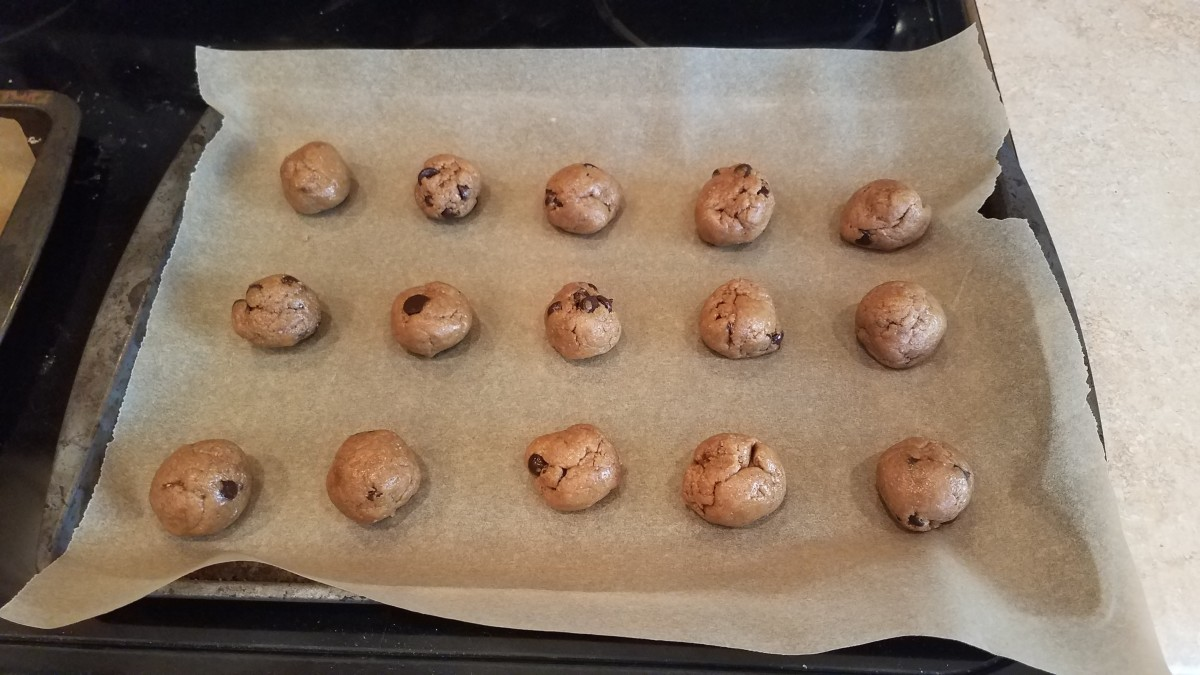 Roll your cookie dough into balls and space them out evenly on your cookie sheet.