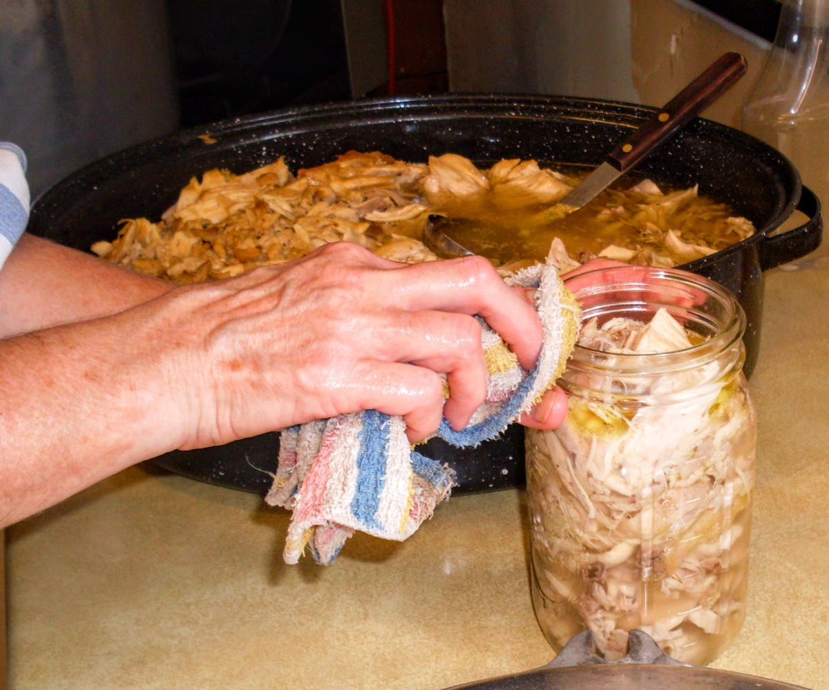 Set aside each jar, dribbles and all, and proceed to fill as many as your canner will hold (usually seven quarts).