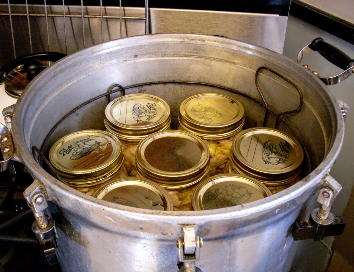 With a rack set in the bottom, fill canner with the appropriate number of jars.