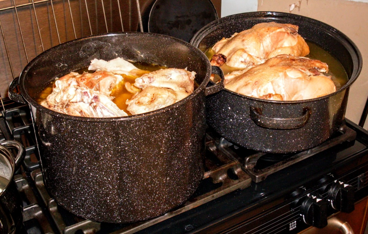 We filled each vessel about halfway with good water, to make a deeply colored broth. Of course, the quality of your chickens and how long you cook them will determine the color and richness of the broth.