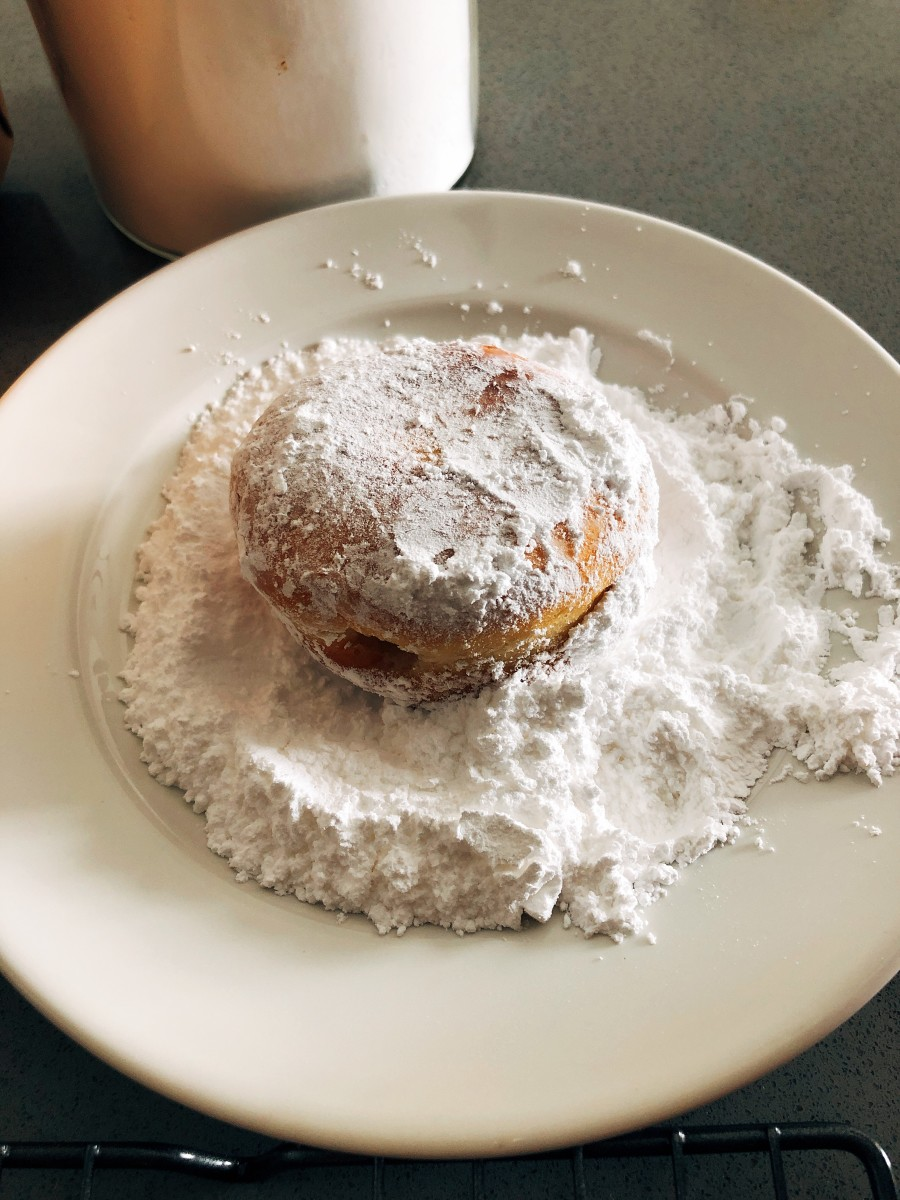Place confectioners' sugar and/or some cinnamon sugar, if desired, into a medium bowl. Add donuts a few at a time and toss until coated evenly.