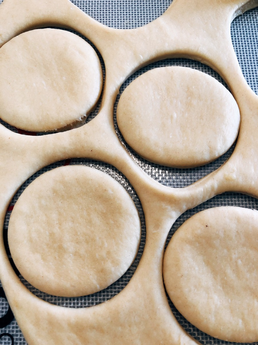 Shape the donuts using a donut cutter.