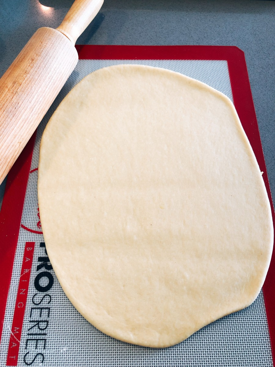 Using a rolling pin, roll the dough to your preferred thickness.