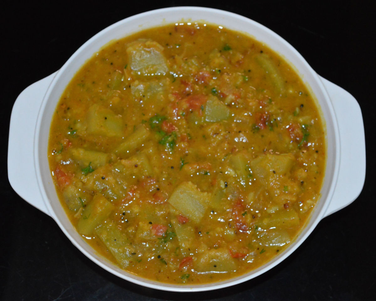 Now your favorite bottle gourd lentil curry is ready to serve! Serve hot with roti, rice, chapati, or any other flatbread. Relish the combo!