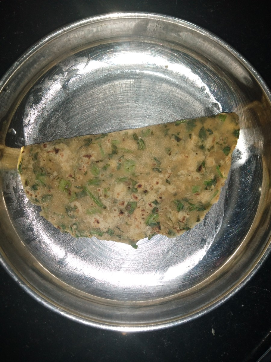 Heat tawa and place the tepla on it. Cook on medium to high flame, flipping and cooking on both sides while applying ghee or oil. Serve hot.