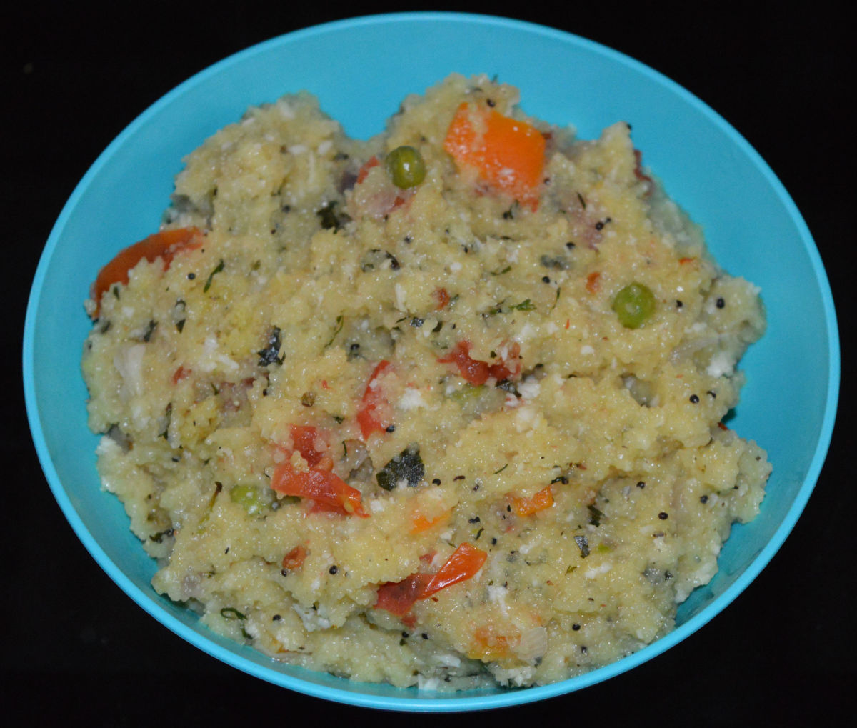 Upma made with instant mix. I added cooked vegetables, too.