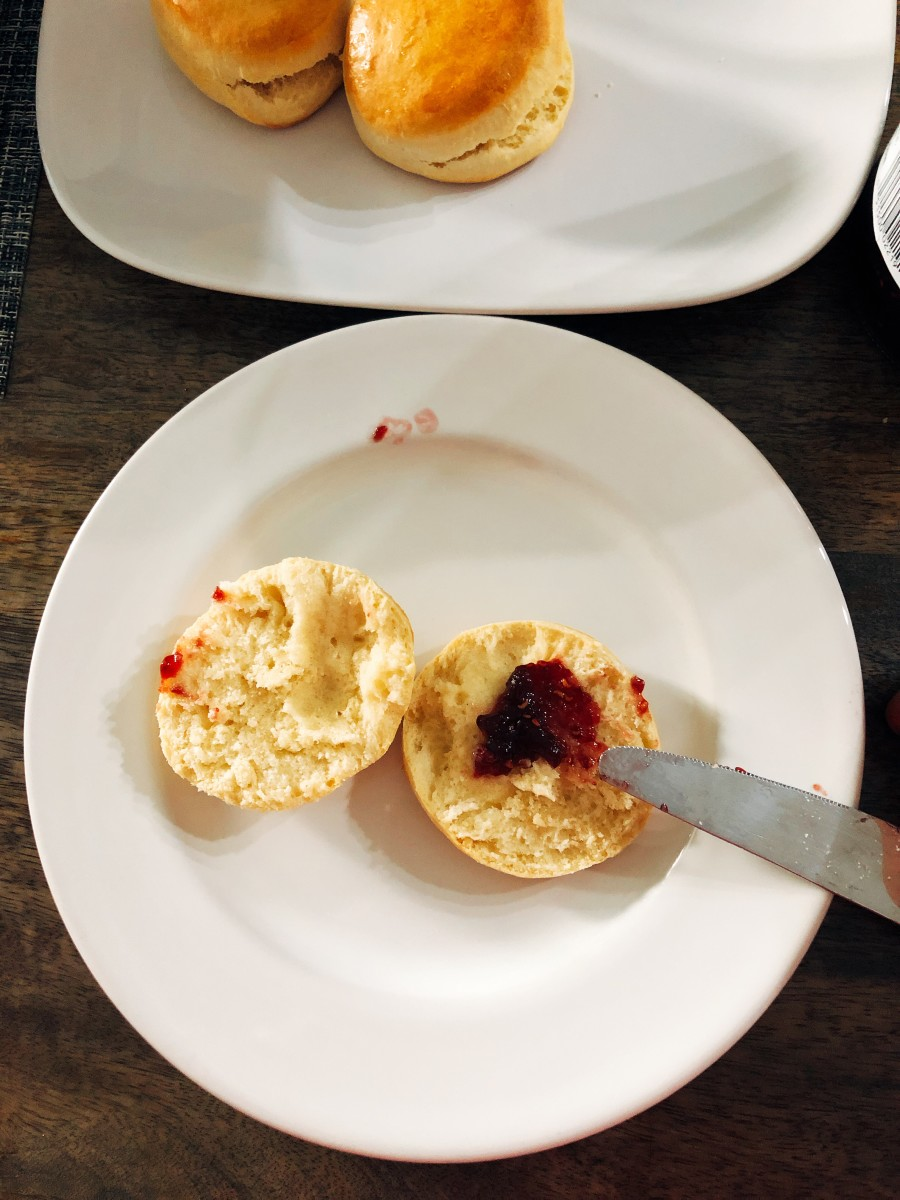 Slice a scone and spread with butter or jam.
