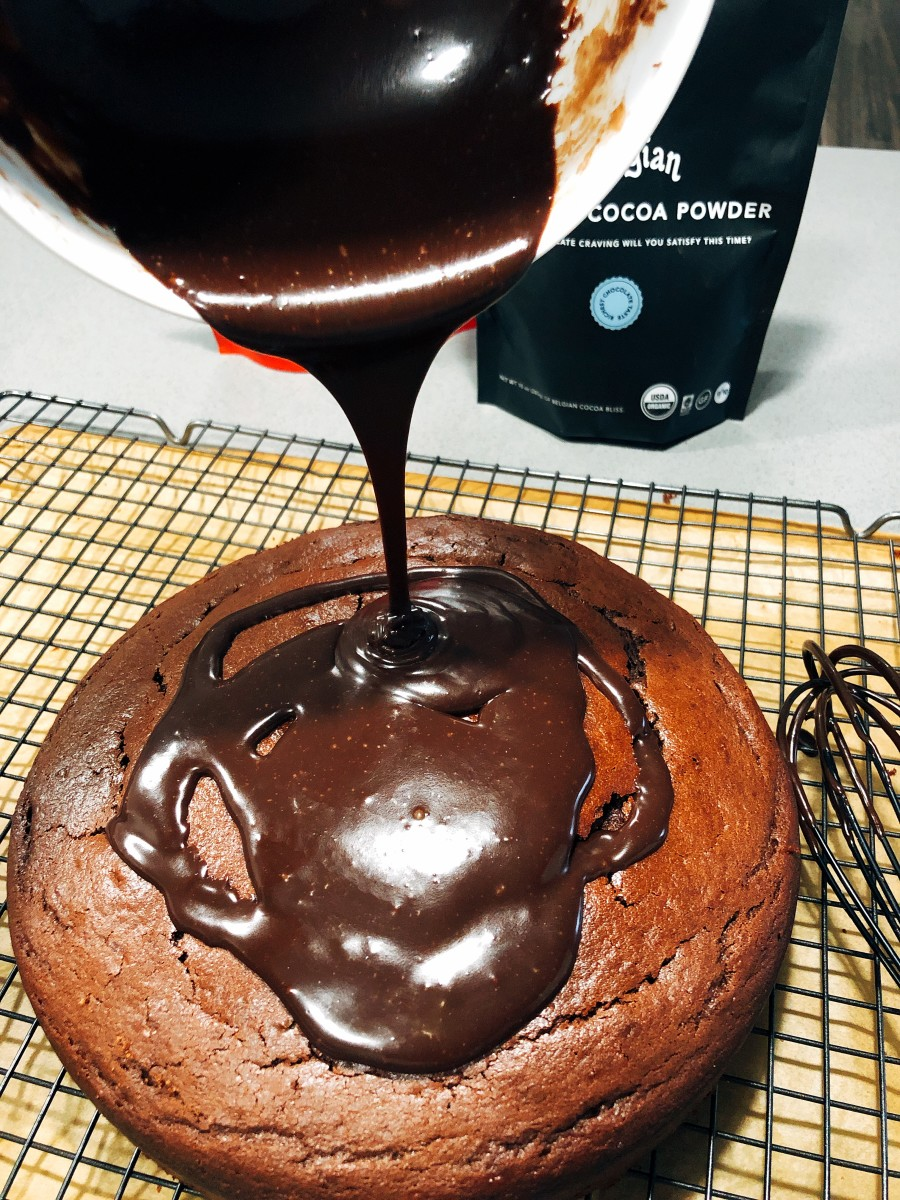 Pour the chocolate ganache on top of the cake.