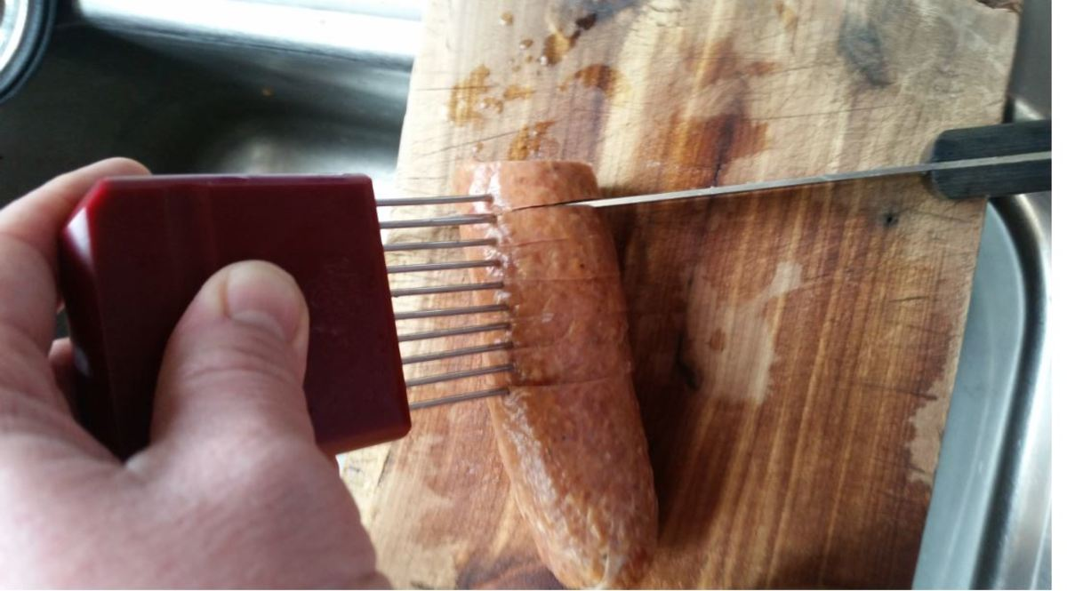 using Pampered Chef holding tool for even slices